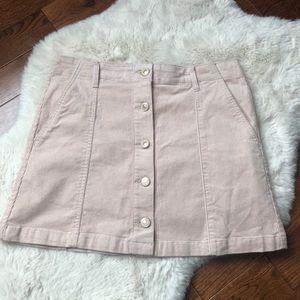 Buttoned corduroy mini skirt